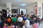 The founder of HU Greene, Ahmed, preps the students on the day of the project.